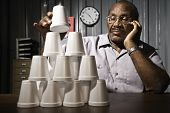 pic of senior class  - Senior African American male worker stacking cups - JPG
