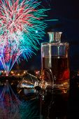 image of debauchery  - bottle of whiskey on a background of fireworks - JPG