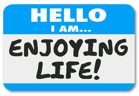 foto of retirement  - Hello I Am Enjoying Life words on a nametag sticker introducing you as someone relaxing or taking pleasure in time off like holiday - JPG