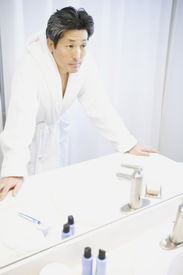 picture of pep talk  - Asian man looking in bathroom mirror - JPG