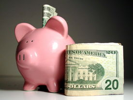image of save money  - piggy bank with us currency saving with a piggy bank money and a pink piggy bank saving money putting money away  - JPG