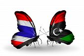 stock photo of libya  - Two butterflies with flags on wings as symbol of relations Thailand and Libya - JPG