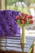 stock photo of vase flowers  - A vase of artificial flowers on the table - JPG