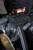 stock photo of extremist  - Closeup photo of armed man in black mask - JPG
