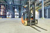 stock photo of pallet  - forklift loader pallet stacker truck equipment at warehouse - JPG