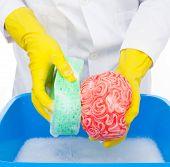 foto of brainwashing  - Metaphor of brainwashing doctor washes the brain with the sponge - JPG