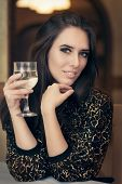 pic of table manners  - Portrait of a classical beauty toasting with a glass of champagne  - JPG