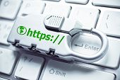 picture of cybercrime  - security lock with https on computer keyboard - JPG