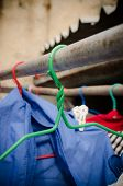 stock photo of clothes hanger  - Close up of old clothes hangers. outdoor (colorful, hangers, old) ** Note: Visible grain at 100%, best at smaller sizes - JPG