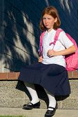 Girl with backpack poster