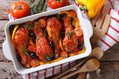 stock photo of chicken  - Chicken legs baked in tomato sauce with olives close - JPG