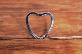 foto of gap  - metallic heart inserted in wooden gap with focus on heart - JPG