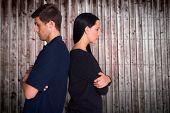 image of not talking  - Couple not talking after argument against wooden planks - JPG