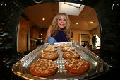 foto of wheat-free  - A sweet lady bakes up a batch of GLUTEN FREE Cookies - JPG