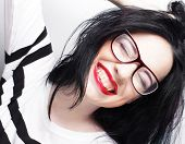 stock photo of shot glasses  - Beautiful young expression  brunette woman wearing glasses - JPG