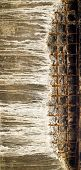 picture of reinforcing  - Grey concrete block with visible rusty reinforcing mesh - JPG
