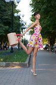 picture of leggy  - Happy beautiful model jumping on street - JPG