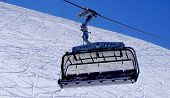 foto of tit  - Empty ski cable car close up at snow mountains Titlis Engelberg Switzerland - JPG