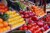 stock photo of stall  - Fresh fruits and vegetables in wooden crates sold on market stall - JPG
