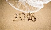 pic of off-shore  - New Year 2016 digits written on seashore and being washed off by wave - JPG