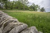 pic of tallgrass  - old limestone fence and grassy meadow - JPG