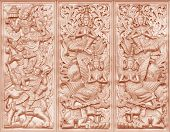 stock photo of sukkot  - Wood carving Buddhist art the walls Thailand - JPG