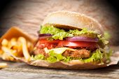 pic of hamburger-steak  - Delicious hamburger and fries on wooden background - JPG