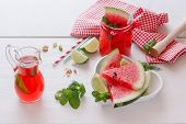 stock photo of watermelon slices  - Watermelon fruit drink with pistachio - JPG