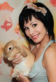 image of dwarf rabbit  - portrait of a girl with a little dwarf rabbits   - JPG