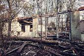 picture of abandoned house  - Shabby abandoned house with cracked color paint - JPG