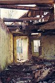 image of abandoned house  - Shabby abandoned house with cracked color paint - JPG