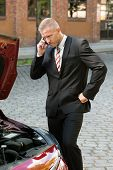 pic of breakdown  - Stressed Young Man Calling On Cellphone For Service With His Breakdown Car - JPG