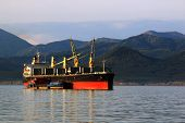 stock photo of coal barge  - a huge bulk carrier loaded with coal from a barge on the roads of Sakhalin island - JPG
