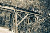 pic of dirt road  - Wood Railroad Bridge over Country Dirt Road - JPG