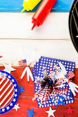 picture of barbie  - Table set with white blue and red decorations for July 4th barbecue. ** Note: Soft Focus at 100%, best at smaller sizes - JPG