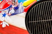 picture of barbie  - Table set with white blue and red decorations for July 4th barbecue. ** Note: Shallow depth of field - JPG