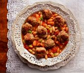 image of meatball  - Meatballs with sauce and beans on table - JPG