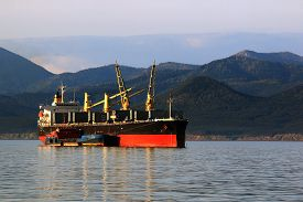 picture of coal barge  - a huge bulk carrier loaded with coal from a barge on the roads of Sakhalin island - JPG