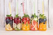 Refreshing infused water summer drinks with fruits and mint poster