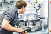 metal machining industry. Worker operating cnc milling machine poster