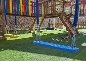 Постер, плакат: Childrens Outdoor Play Area With Swings