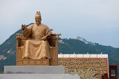 stock photo of hangul  - A statue of King Sae Jong Dae in front of the Gyeongbokgung palace complex in Seoul South Korea - JPG
