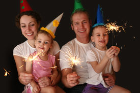 picture of new years baby  - family of four with sparklers on the birsday - JPG