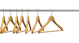 pic of clothes hanger  - Set of wooden coat hangers on clothes rail isolated on white background - JPG