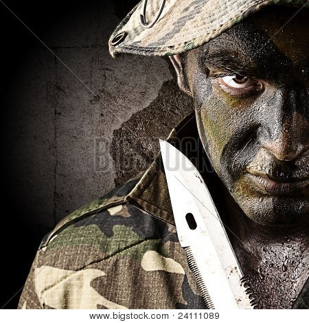 portrait of young soldier trying