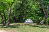 Tent Camping In Beautiful Outdoor Setting With Trees And Sunshine. Fun And Relaxation Of Spring Summ poster