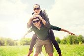 travel, hiking, backpacking, tourism and people concept - happy couple with backpacks having fun and poster