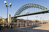stock photo of tyne  - View of Tyne bridge with lamp posts from the south bank - JPG