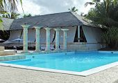 foto of greater antilles  - holiday resort with pool at the Dominican Republic a island of Hispanola wich is a part of the Greater Antilles archipelago in the Carribean region - JPG
