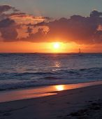 image of greater antilles  - beach with sunset at the Dominican Republic a island of Hispanola wich is a part of the Greater Antilles archipelago in the Carribean region - JPG